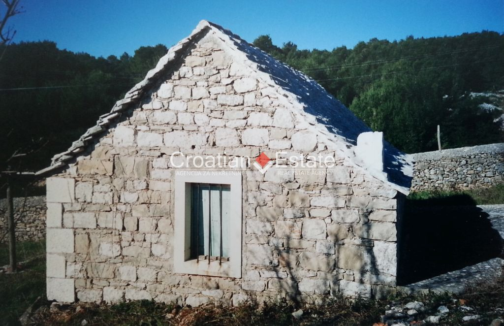Island Brac, old stone cottage on a large building plot for