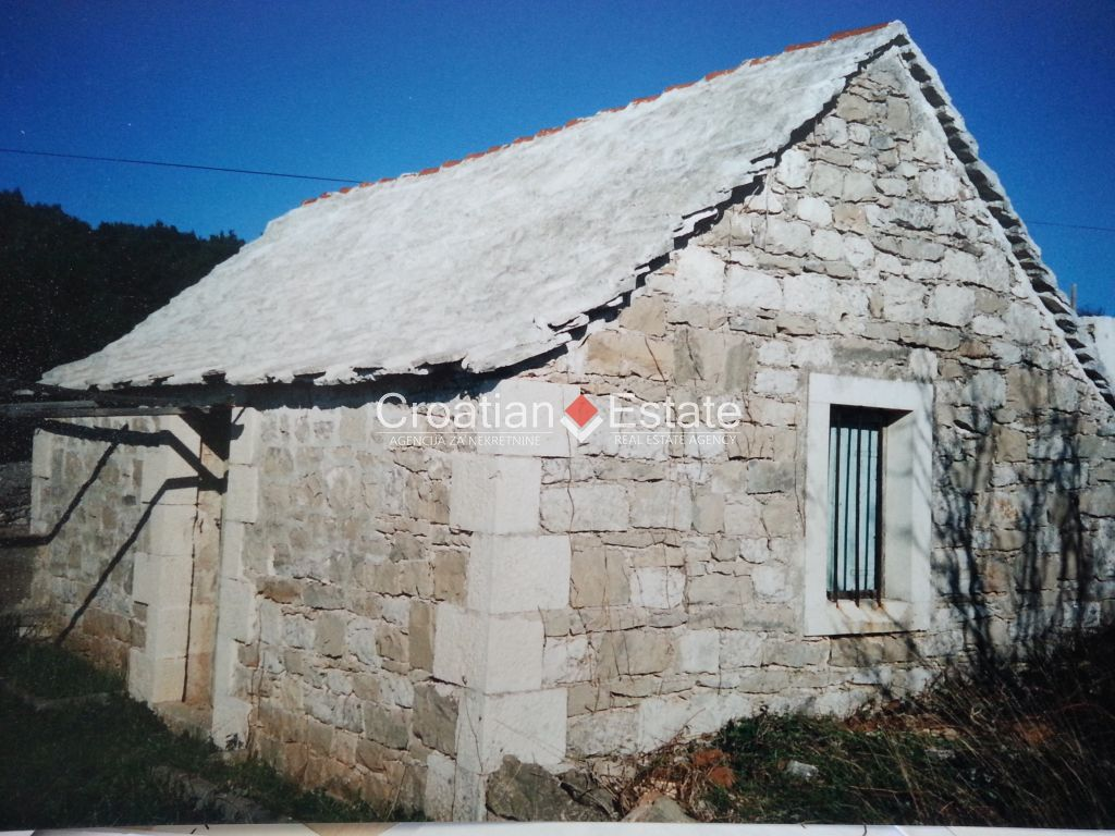 Island Brac, old stone cottage on a large building plot for sale