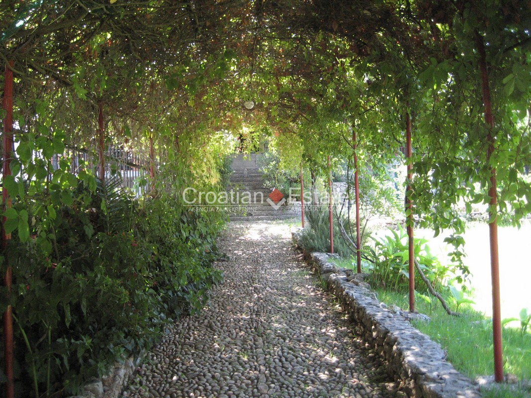 Island Brač – seafront building land with an old house for sale