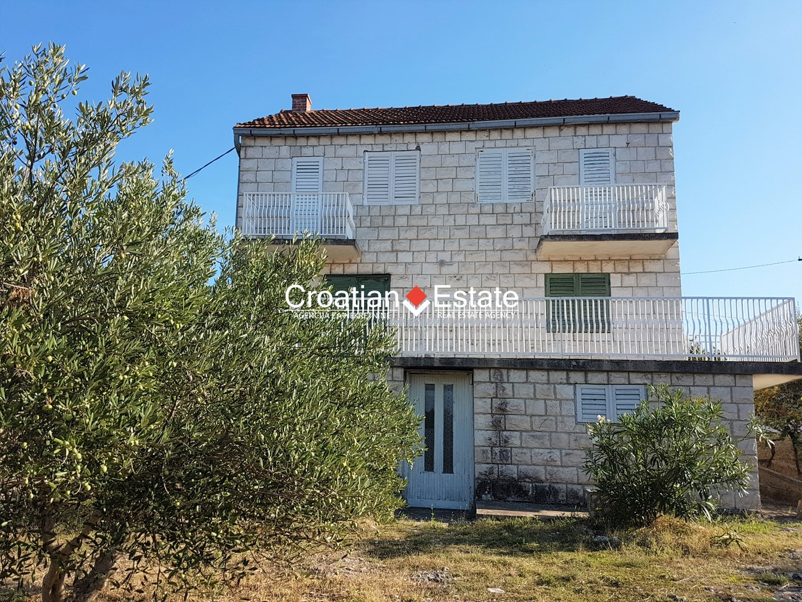 Island Brač – family house on a large plot with sea view for sale
